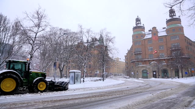 snowcat, snow bulldozer, clear snowfall from road stockholm sweden - snowplough stock videos & royalty-free footage