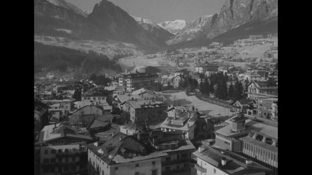 gv snowcovered alpine mountain range / gv various aerial shots of snowcovered streets and buildings in cortina / note exact day not known - cortina stock videos & royalty-free footage