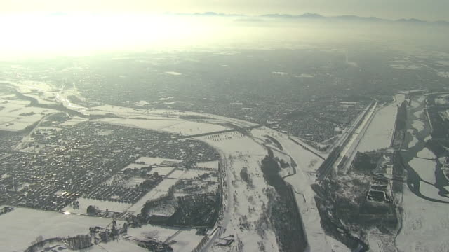 aerial snow-covered city of obihiro, hokkaido, japan - 平地点の映像素材/bロール