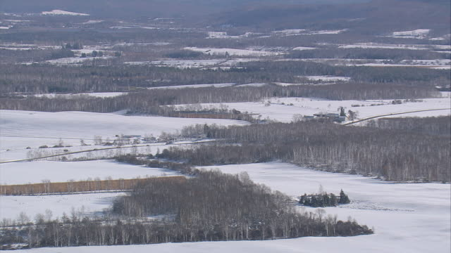 aerial snow-covered landscape and fields in rural new york / united states - 30 seconds or greater stock videos & royalty-free footage