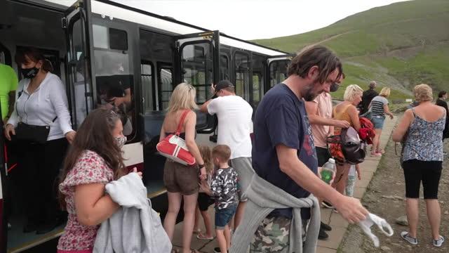 snowdon mountain railway taking tourists to the cafe halfway up mount snowdon - leisure activity stock videos & royalty-free footage