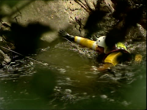 body of missisng schoolboy found search party by rushing river - snowdonia video stock e b–roll