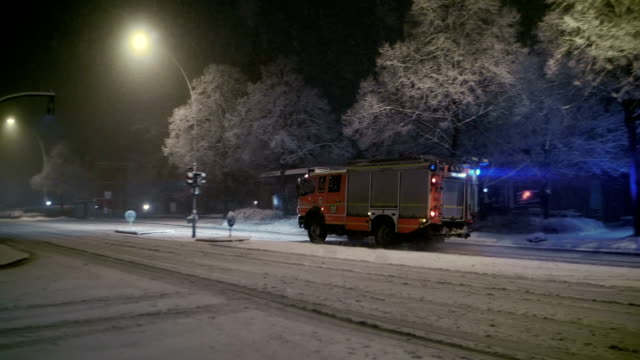 snowfall at night with fire truck slow motion - fire station stock videos & royalty-free footage