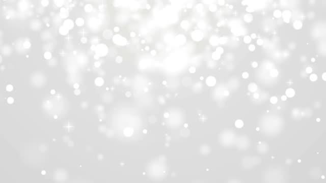 vídeos de stock, filmes e b-roll de neve desfocagem com estrelas. - cinza descrição de cor