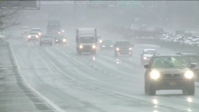 snowfall in long island cars driving on an expressway in the snow on december 10 2013 in hempstead new york - long island railroad stock videos and b-roll footage