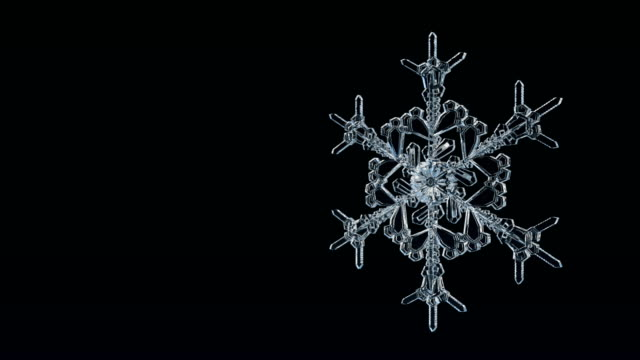 snowflake ice crystal loop 4k. - christmas lights stock videos & royalty-free footage