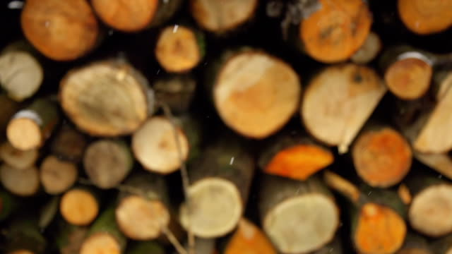 HD SUPER SLOW-MO: Snowflakes And Firewood