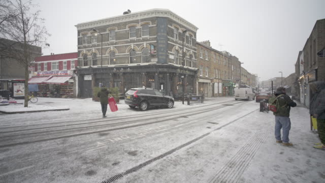 snowing in london at broadway market in march - hackney stock videos & royalty-free footage