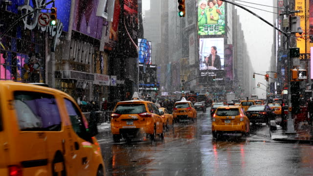 snowing in times square - digital signage stock videos and b-roll footage