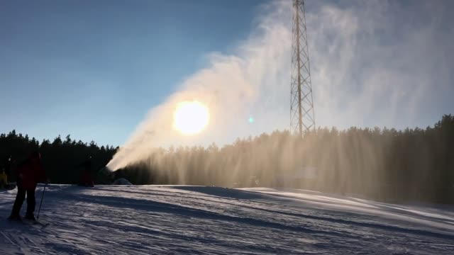 snowmaking is the production of snow on ski slopes, slow motion - cannon stock videos & royalty-free footage