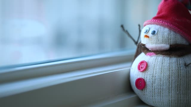 snowman by window - warm clothing stock videos & royalty-free footage