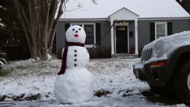 A snowman is seen as snow that fell yesterday and cold weather blanket the area on January 4 2018 in Savannah Georgia From Maine to Florida every...