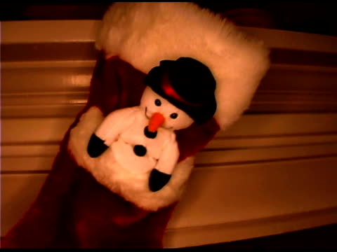 snowman on stocking - see other clips from this shoot 1407 stock videos and b-roll footage