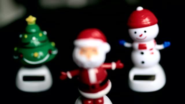 Snowman, santaclause, christmas tree, black background, funny, happy