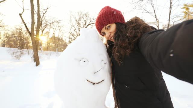 snowman selfie. - making a snowman stock videos & royalty-free footage