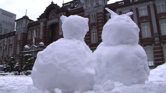 snowmen in front of tokyo station - kanto region stock videos & royalty-free footage