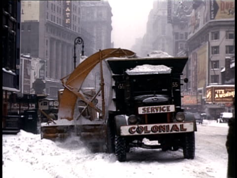 1940 ws snowplow and truck clearing street of snow / new york city, new york, usa - anno 1940 video stock e b–roll