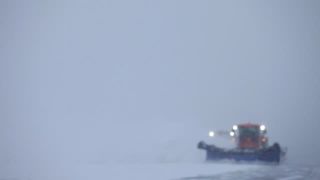 snowplow comes into focus and clears airstrip - plowing stock videos & royalty-free footage