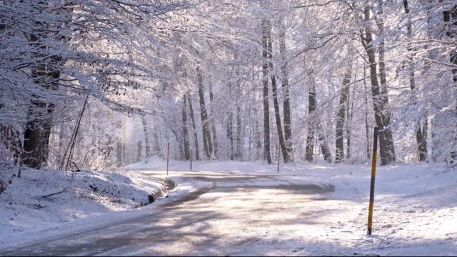 SLO MO Snowplow Markings Along Snowy Road