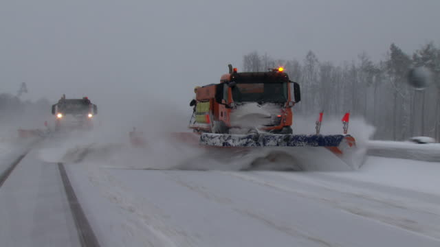 snowplow on german autobahn - winter stock videos & royalty-free footage