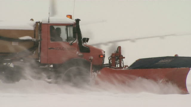 TS Snowplow truck clearing snow at Incheon International Airport / Incheon, South Korea