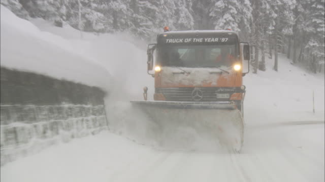 Snowplow Truck Removing the Snow from the Highway