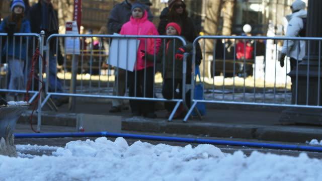 snowplow with spectators, autonomous snowplow competition - saint paul stock-videos und b-roll-filmmaterial