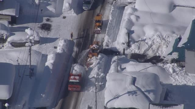 aerial, snowplows in deep snow, akita, japan - 秋田県点の映像素材/bロール
