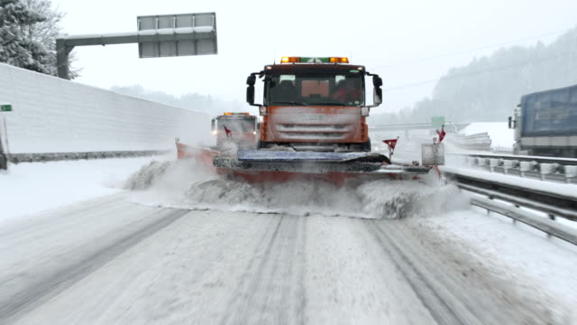 snowplows removing snow from the highway - snowplough stock videos & royalty-free footage