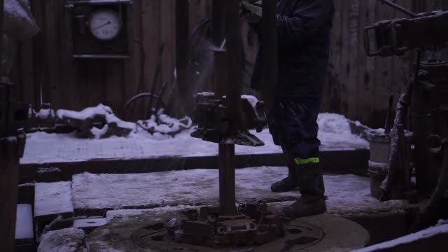 snows falls to the base of an oil drilling rig at the oil and gas field processing and drilling site operated by ukrnafta pjsc in gnidyntsi,... - wrench stock videos & royalty-free footage