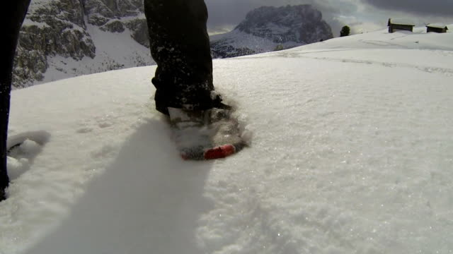 pov snowshoeing in high mountain landscape - langkofel stock videos & royalty-free footage