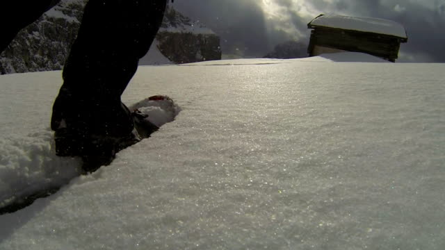 pov snowshoeing in high mountain landscape - shack stock videos and b-roll footage