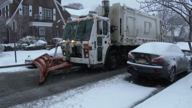 snowstorm / snow plow clearing street - queens, nyc - snowplough stock videos & royalty-free footage
