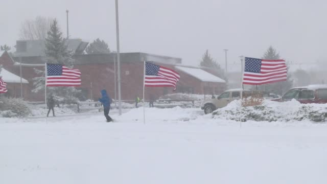 A snowstorm that packed high winds and heavy wet snow pounded Centennial in the south Denver metro area Wednesday morning on Veteran's Day Students...