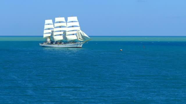snow-white vintage sailboat in the sea - veliero video stock e b–roll