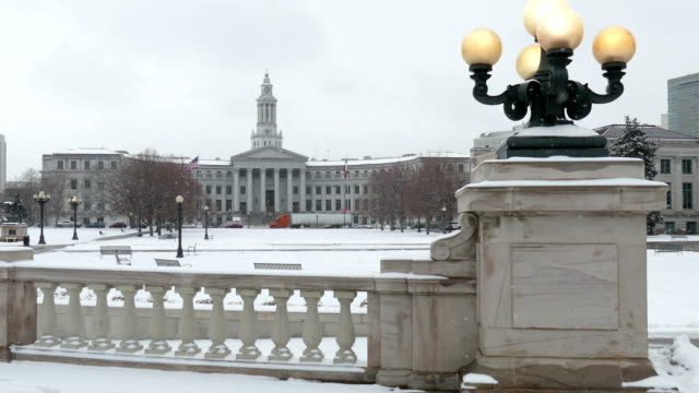 Snowy Civic Center Park Denver County Courthouse lights Colorado winter