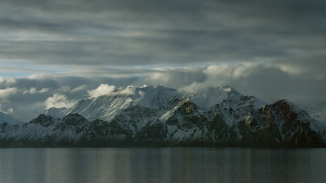 Snowy Coastal Mountains In Canadian Arctic