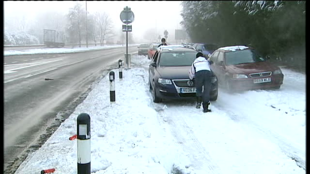 travel disruption; day kate compton pushing car out of snow and interview sot - kate snow stock videos & royalty-free footage