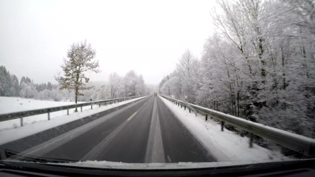 POV snowy country road in winter, Bavarian forest, Bavaria, Germany