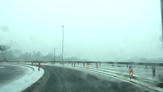 snowy highway - slow motion - slush stock videos and b-roll footage