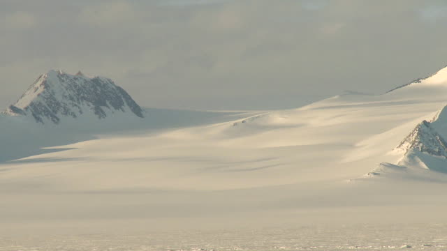 ws pan of snowy mountain landscape / union glacier, heritage range, ellsworth mountains, antarctica  - south pole stock videos & royalty-free footage