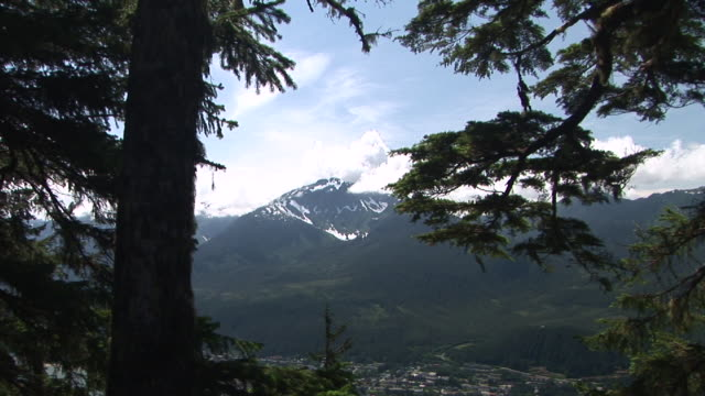 ws, zi, snowy mountain peak and clouds seen from mount roberts, juneau, alaska, usa - juneau stock videos and b-roll footage