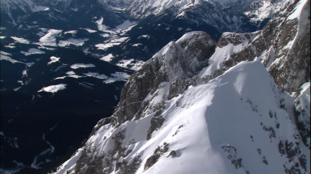 snowy mountain peaks make up the german alps in bavaria, germany. - bavarian alps stock videos & royalty-free footage