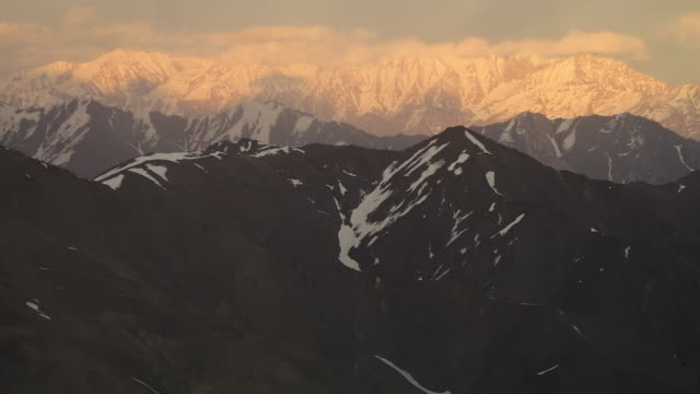 snowy mountain peaks touching the sky - solid stock videos & royalty-free footage