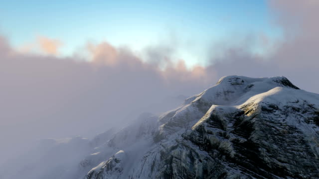 Snowy Mountains and Moving Clouds