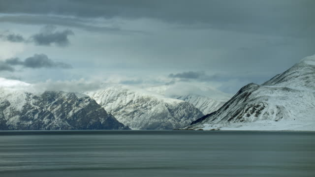 Snowy Mountains In Arctic Coastal Landscape
