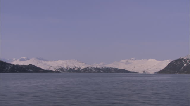 snowy mountains surround prince william sound, alaska. - prince william stock videos & royalty-free footage