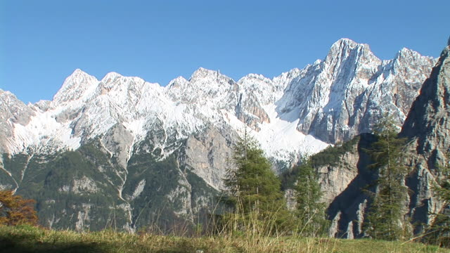 hd: snowy mountains - slovenia meadow stock videos & royalty-free footage