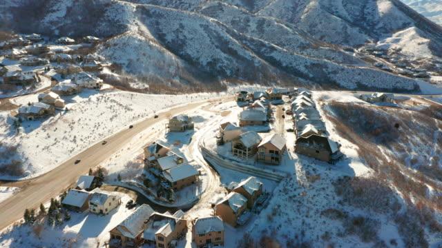 snöiga kvarter drone antenn utsikt - village bildbanksvideor och videomaterial från bakom kulisserna