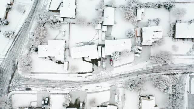 snowy neighborhood drone aerial view - snowplough stock videos & royalty-free footage